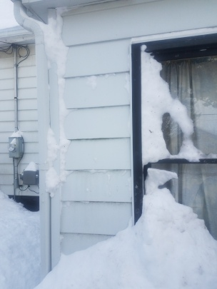 Snow blown all over the windows...