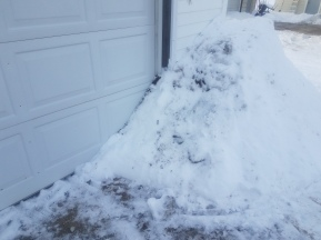 Snow blown all over the garage...